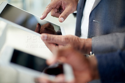 Buy stock photo Shot of unrecognizable businesspeople using their digital devices at work