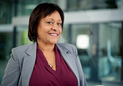 Buy stock photo Portrait of a cheerful mature businesswoman standing in her office at work