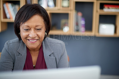 Buy stock photo Shot of an attractive mature businesswoman working on a computer in her office