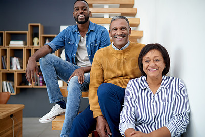 Buy stock photo Portrait of a cheerful mature couple relaxing with their adult son at home