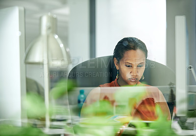 Buy stock photo Cropped shot of an attractive young businesswoman sitting at her desk while in the office during the day