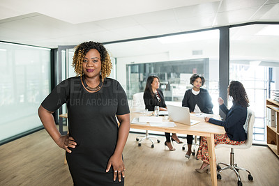 Buy stock photo Portrait of a confident businesswoman having a meeting with colleagues in a modern office