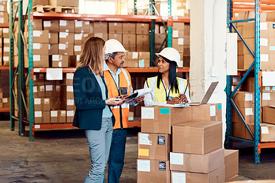 Buy stock photo Shot of a group of factory workers having a discussion in a warehouse