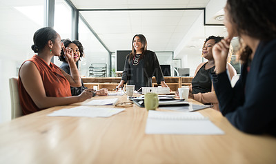 Buy stock photo Shot of a young businesswomen asking a question during a meeting with colleagues