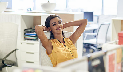 Buy stock photo Cropped portrait of an attractive young businesswoman leaning back in her chair with her hands behind her head in the office
