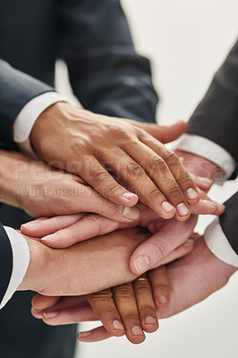 Buy stock photo Closeup shot of a group of unrecognizable businesspeople standing in a huddle with their hands stacked together