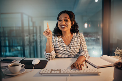 Buy stock photo Shot of a beautiful young businesswoman using a digital interface while working late in her office