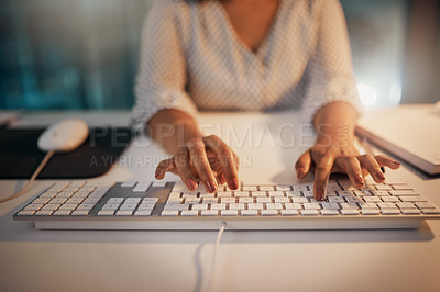 Buy stock photo Shot of an unrecognizable businesswoman typing on a keyboard while working late in her office