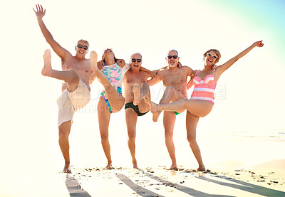 Buy stock photo Full length shot of a group of senior friends having fun together at the beach during the day