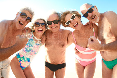 Buy stock photo Cropped portrait of a group of senior friends having fun together at the beach during the day