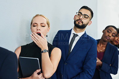 Buy stock photo Cropped shot of an attractive young businesswoman feeling tired and yawning while waiting in line for an office interview