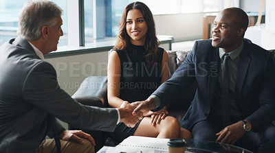 Buy stock photo Shot of a group of businesspeople having a discussion while sitting together on a couch at the office