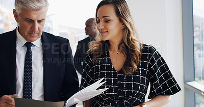 Buy stock photo Shot of two businesspeople discussing something while walking together