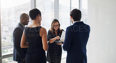 Buy stock photo Shot of a group of businesspeople standing together in an office