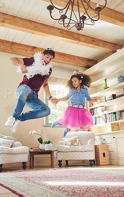 Buy stock photo Full length shot of a happy young father playing dress up with his daughter at home