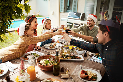 Buy stock photo Cropped shot of a family making a toast on Christmas day
