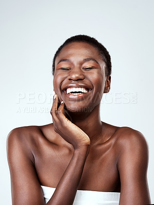 Buy stock photo Studio shot of a beautiful young woman feeling her skin against a grey background
