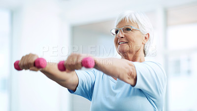 Buy stock photo Shot of cheerful senior woman working out using dumbbells at home