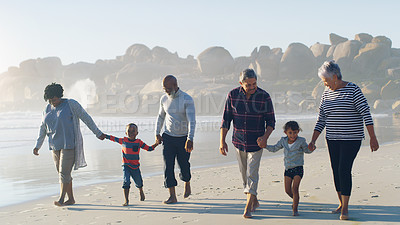Buy stock photo Full length shot of a senior group of friends enjoying a day on the beach with their grandchildren
