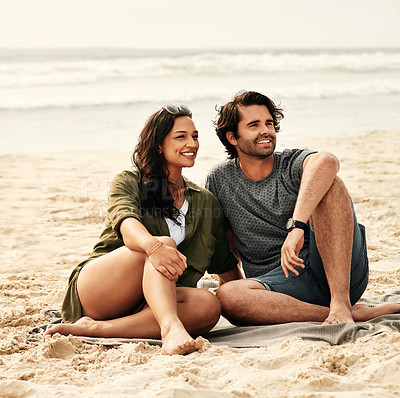 Buy stock photo Full length shot of an affectionate young couple spending time together at the beach