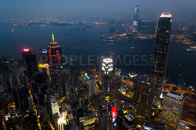Buy stock photo Aerial shot of skyscrapers, office blocks and other commercial buildings in the urban metropolis of Hong Kong
