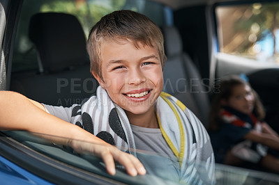 Buy stock photo Cropped portrait of a young boy sitting in the car before going on a roadtrip with his family