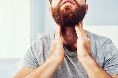 Buy stock photo Cropped shot of an unrecognizable man suffering with a sore throat