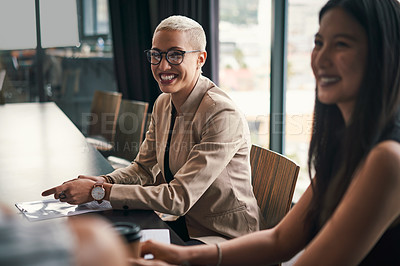 Buy stock photo Shot of a group of attractive young businesswomen having a meeting and discussing ideas inside an office