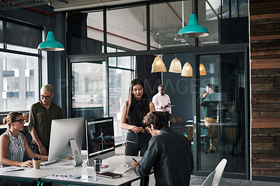 Buy stock photo Shot of a group of young businesspeople working inside a modern office