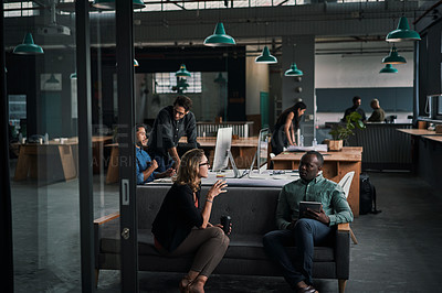 Buy stock photo Shot of a group of businesspeople working together in a modern office
