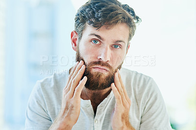 Buy stock photo Cropped shot of a handsome young man going through his morning routine