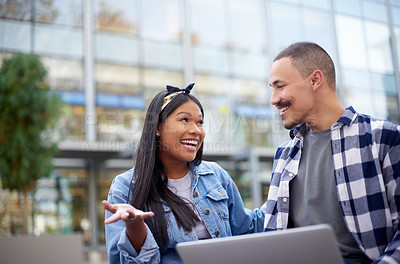 Buy stock photo Shot of a happy young couple using a laptop together at university