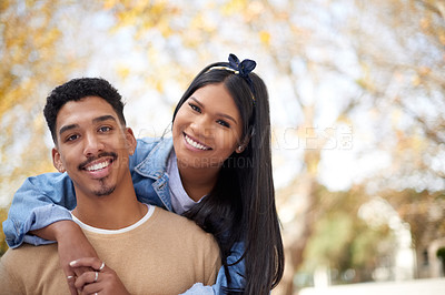 Buy stock photo Shot of a happy young couple having fun outdoors at university