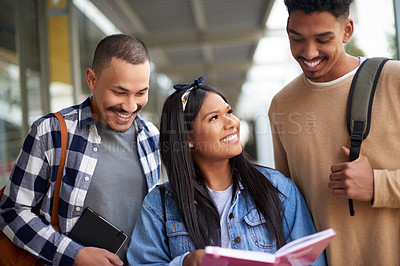 Buy stock photo Shot of a group of young students having a study session outside at university