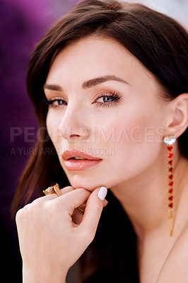 Buy stock photo Shot of a glamorous young woman posing outdoors