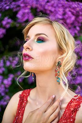 Buy stock photo Shot of a beautiful young woman dressed in elegant wear standing outdoors