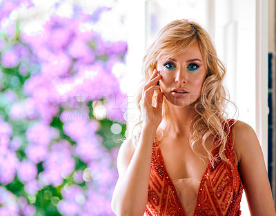 Buy stock photo Shot of a beautiful young woman dressed in elegant wear at home
