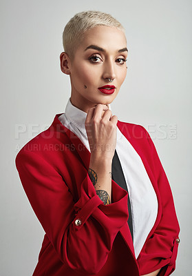 Buy stock photo Portrait of an attractive young and stylish businesswoman posing against a grey background