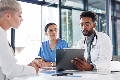 Buy stock photo Shot of a group of medical practitioners having a meeting in a hospital boardroom