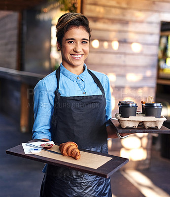 Buy stock photo Portrait of an attractive young barista serving food and drinks at her cafe