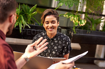 Buy stock photo Shot of an attractive young businesswoman having a meeting with a colleague at an outdoor cafe