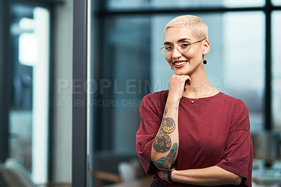 Buy stock photo Cropped portrait of an attractive young businesswoman standing alone in her office and resting her hand on her chin