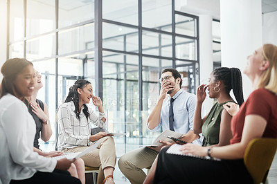 Buy stock photo Cropped shot of a diverse group of businesspeople sitting in the office together and laughing during a meeting