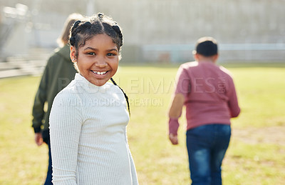 Buy stock photo Shot of a young schoolgirl playing outside on a school field during recess