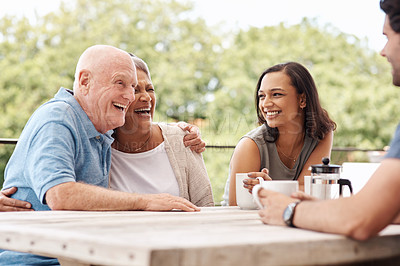 Buy stock photo Shot of a happy family spending quality time together outside at home