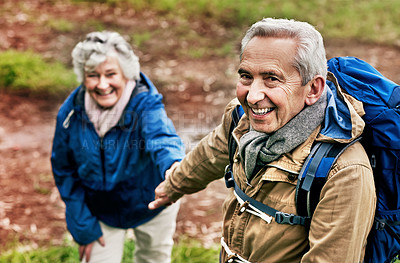 Buy stock photo Shot of a senior couple going for a hike in nature