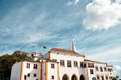 Buy stock photo Shot of a government building with the national flag standing on the rooftop in Sintra, Portugal
