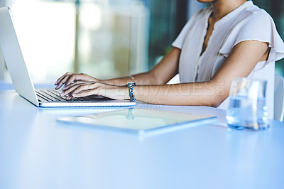 Buy stock photo Closeup shot of an unrecognisable businesswoman working on a laptop in an office
