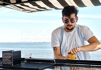 Buy stock photo Cropped shot of a handsome young man standing alone and opening a bottle before mixing a cocktail