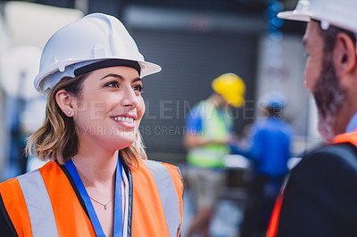Buy stock photo Cropped shot of two confident engineers having a discussion together inside of a workshop